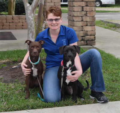veterinary technician with her two pit bull mixes