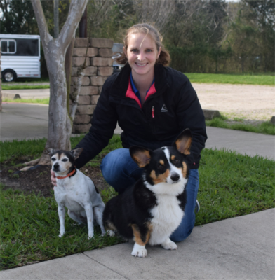 veterinarian with her terrier mix and corgi