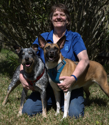 veterinary assistant with her cattle dog and malinois mix