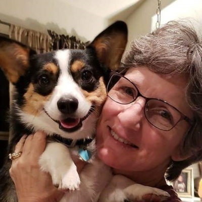 practice manager with her corgi
