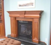 CUSTOM FIREPLACE IN CHERRY TO MATCH ADJACENT CABINETRY, HAND FINSIHED