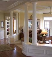 LARGE LIVING ROOM SEPERATED BY ELEGANT COLUMNS
