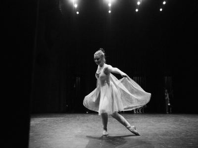 Ballet dance performs on stage in The Nutcracker.