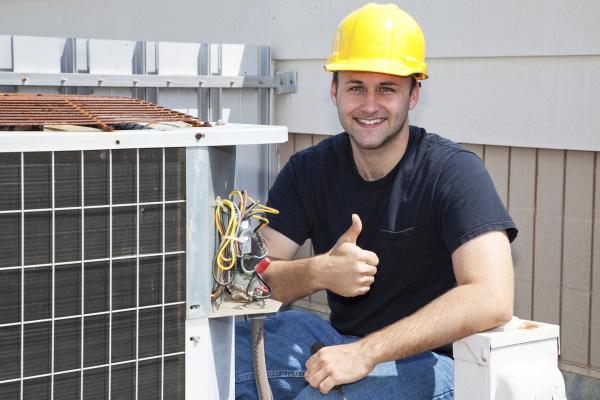 "alt=""Industry trained technician repairing air conditioner"">""."