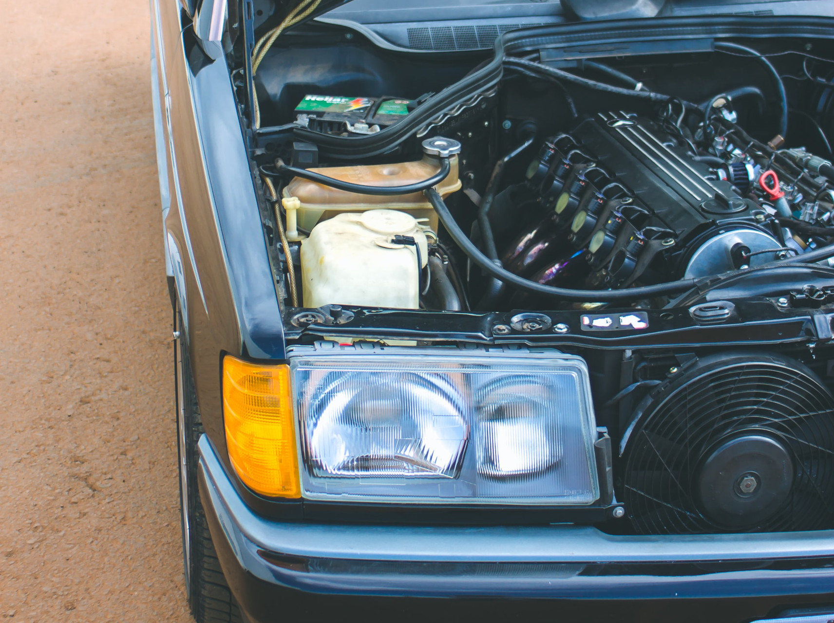 Car with opened hood: the engine