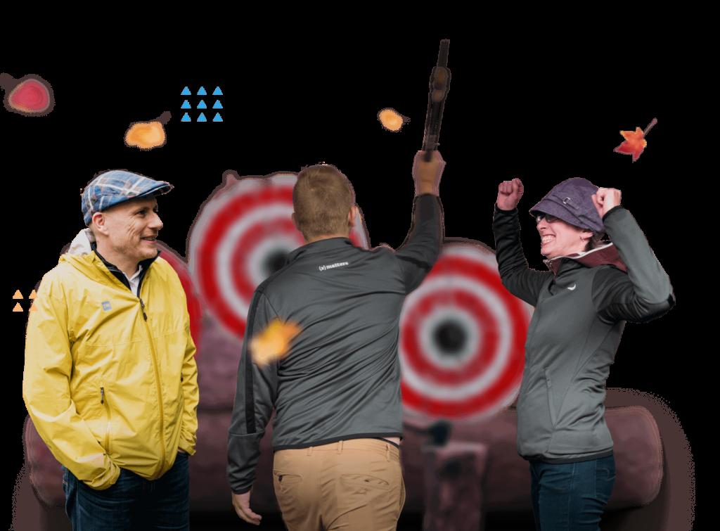 xMatters employees having fun throwing axes