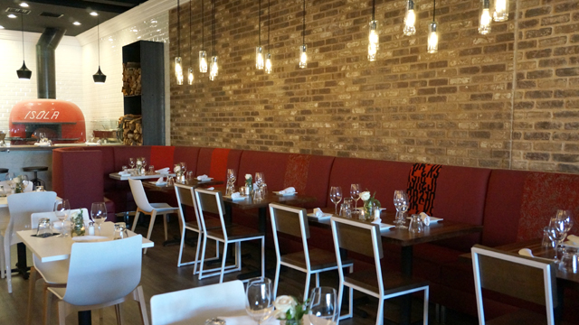 The Dining Room Has Full View Of Isola S Wood Burning Oven Including From Counter Seats At Pizza Bar